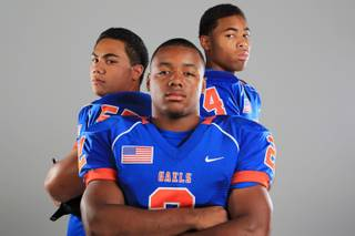 Bishop Gorman football players Marquis Hunkin, Tajon Allen and Jamir Tillman Thursday, July 26, 2012.