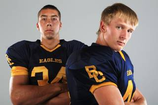 Boulder City football players Michael Kelso and D. J. Koopman Thursday, July 26, 2012.