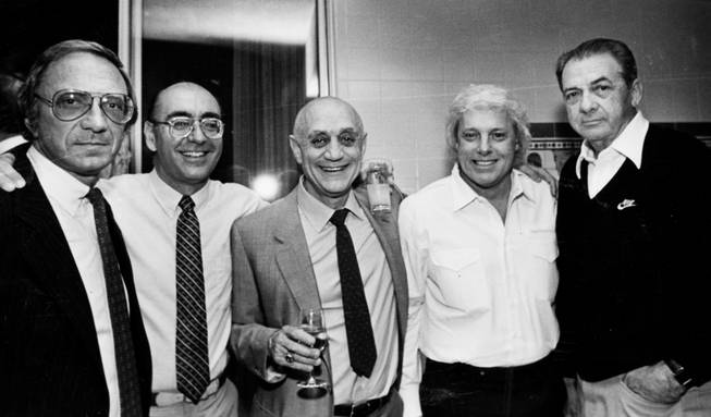 UNLV basketball coach Jerry Tarkanian is seen with, from left, ...