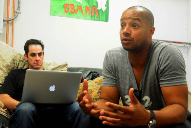 "Actor Donald Faison, left, participates in media interview at a Barack Obama presidential campaign office in Las Vegas on Saturday, July 28, 2012. Faison and co-star Zach Braff from the popular TV sitcom ""Scrubs"" were in town to support volunteers canvassing in the central valley. To the right of Faison is Jason Karsh, digital director of Obama's Nevada campaign offices."