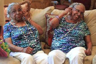 Twins Thelma Woods, left, and Velma McKenney celebrate their 90th birthday Saturday, July 28, 2012.