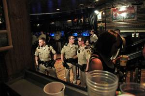 Metro officers guard a cordoned off area after a stabbing brought an early end to a Tenacious D concert at the House of Blues Saturday, July 28, 2012.