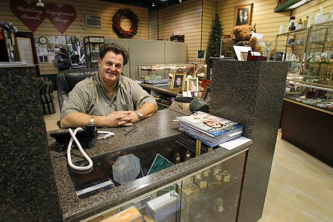 "John Del Prado, CEO of Del Prado Jewelers, mans the shop at the Neonopolis mall in downtown Las Vegas Wednesday, August 1, 2012.  ""After six years here, I'm anxious and excited about everything that is happening,"" he said. ""Neonopolis is finally coming alive."""
