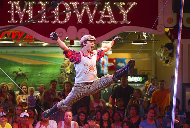 Slack wire artist Evgeny Vasilenko of Russia performs at the Midway at Circus Circus Thursday, August 2, 2012.