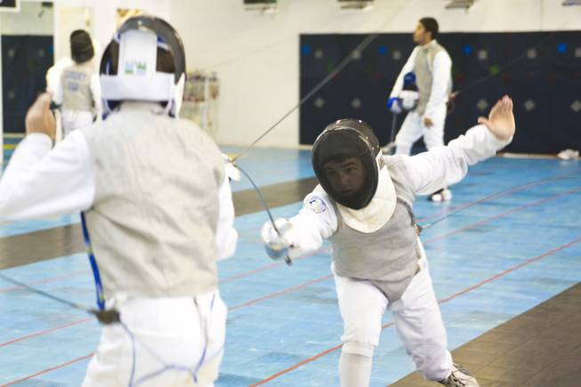 Students at the Fencing Academy of Nevada practice Thursday, Aug. 2, 2012.