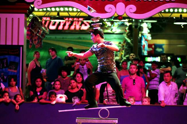 Jason Xiao performs on the Rolla Bola at the Circus Circus Midway in Las Vegas on Thursday, August 2, 2012.