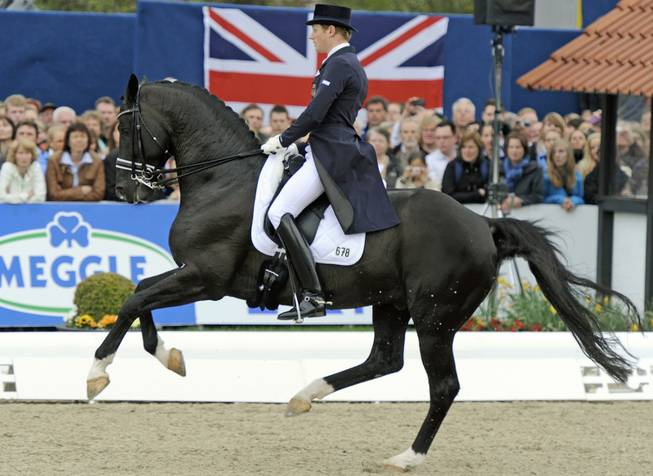 German Matthias Rath on horse Totilas performs his freestyle during the dressage riding Grand Prix International in Hagen, Germany, Sunday, April 29, 2012.