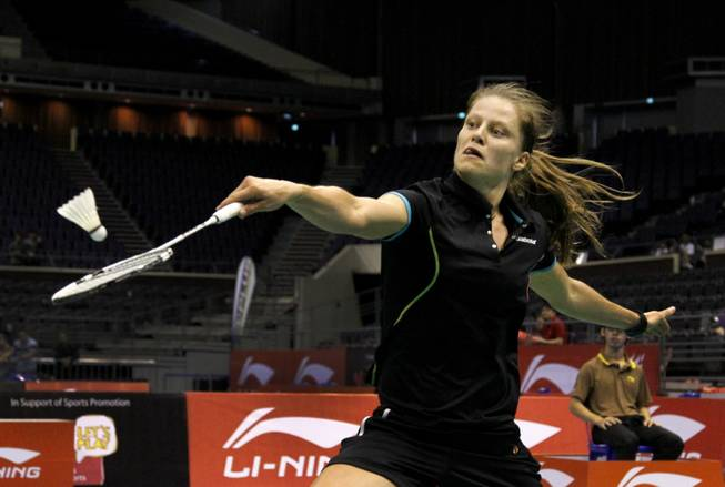 Germany's Juliane Schenk returns a shot to South Korea's Sung Ji Hyun at the Li-Ning Singapore Open Badminton tournament during their semi-finals match held on Saturday June 23, 2012 in Singapore. Schenk won the match 21-11 20-22 21-12.