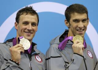 United States' Michael Phelps, right, and United States' Ryan Lochte pose with their medals for the men's 200-meter individual medley swimming final at the Aquatics Centre in the Olympic Park during the 2012 Summer Olympics in London, Thursday, Aug. 2, 2012.
