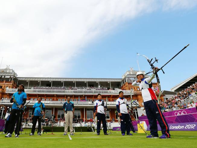 Japan's Takaharu Furukawa, right, competes in the men's team archery eliminations match against India during the 2012 Summer Olympics at Lord's Cricket Ground on Saturday, July 28, 2012, in London.