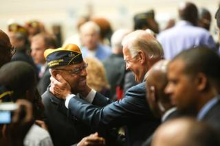 Vice President Joe Biden greets an attendee after Biden's speech at the Disabled American Veterans National Convention at Bally's Hotel Convention Center Saturday, August 4, 2012, in Las Vegas.