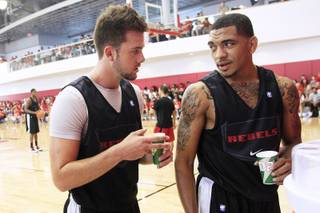 UNLV guards Katin Reinhardt and Anthony Marshall talk during their open practice Saturday, August 4, 2012.