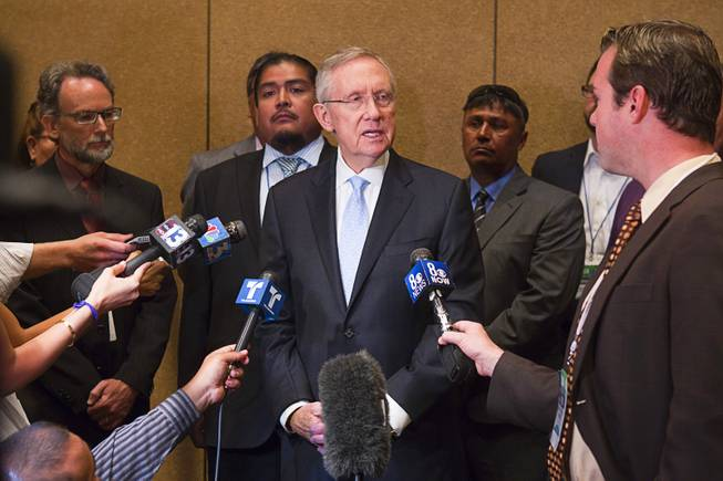 Senate Majority Leader Harry Reid is joined by members of the Moapa band of Paiutes and environmentalists as he calls for the closing of NV Energy's Reid Gardner coal-fired power plant during the National Clean Energy Summit 5.0 at the Bellagio Tuesday, August 7, 2012.