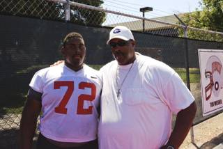 UNLV sophomore Ron Scoggins Jr. with his father Ron Sr. after a UNLV practice.
