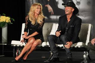 Faith Hill and Tim McGraw laugh while answering questions after announcing their concert series at the Venetian on Tuesday, Aug. 7, 2012.