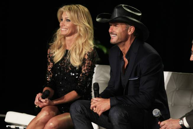Faith Hill and Tim McGraw listen to a question after announcing their concert series at the Venetian on Tuesday, Aug. 7, 2012.