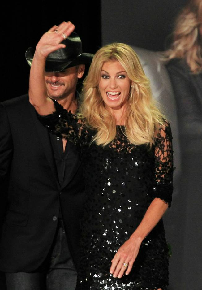 Faith Hill and Tim McGraw greet the audience before announcing their concert series at the Venetian on Tuesday, Aug. 7, 2012.