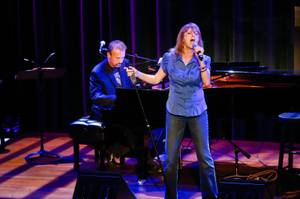 Tina Walsh, accompanied by Philip Fortenberry on the piano, sings a piece at The Composers Showcase at the Cabaret Jazz at The Smith Center, Wednesday Aug. 8, 2012.