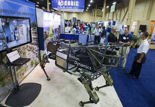 An LS3 robotic mule is displayed at the Boston Dynamics booth during the Association for Unmanned Vehicles Systems International (AUVSI) convention at the Mandalay Bay Thursday, Aug. 9, 2012. The mule, powered by a gasoline engine can carry a 400 lb. payload for 20 miles.