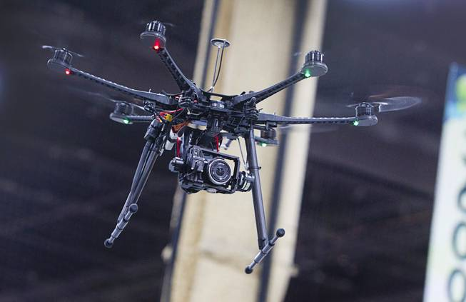 A DJI S800 Hexacopter drone with a gimbal system and DJI Wookong-M Autopilot Controller is demonstrated during the Association for Unmanned Vehicles Systems International (AUVSI) convention at the Mandalay Bay Thursday, Aug. 9, 2012. The $6500.00 system offers filmmakers the ability to record video from unique angles at an affordable price.