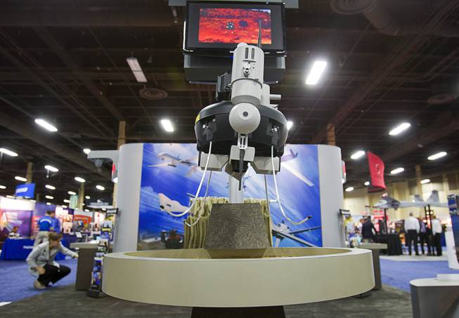 A Honeywell T-Hawk drone is displayed during the Association for Unmanned Vehicles Systems International (AUVSI) convention at the Mandalay Bay Thursday, Aug. 9, 2012. The reconnoissance drone can be carried in a backpack and has vertical take-off and landing capability.