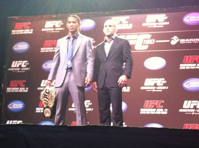 Ben Henderson, left, and Frankie Edgar pose after a press conference to promote UFC 150 on Thursday Aug. 9, in Denver, Colo., in this photo taken on an iPhone.