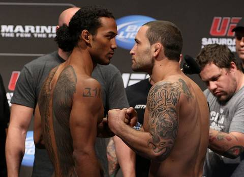 Benson Henderson, left, and Frankie Edgar, right, pose after making weight for their UFC 150 lightweight championship fight Friday August 10 in Denver.