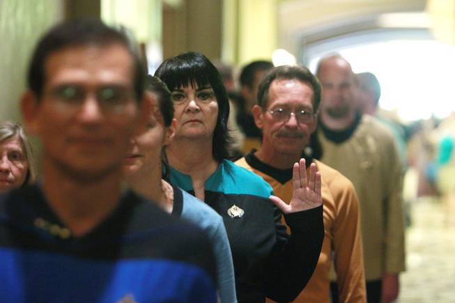 Attendees wait to enter the theater for during an attempt to set the Guinness world record for most people in Star Trek costumes Saturday, August 11, 2012 at the Star Trek convention at the Rio.