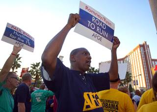 Robert Autrey, a member of the American Federation of Government Employees (AFGE), pickets against the Mitt Romney/Paul Ryan ticket in front of the Venetian on the Las Vegas Strip Tuesday, Aug. 14, 2012. Republican vice presidential candidate Paul Ryan was reportedly meeting privately with a small group of supporters at the casino owned by Sheldon Adelson, a billionaire and major donor to Republican campaigns.