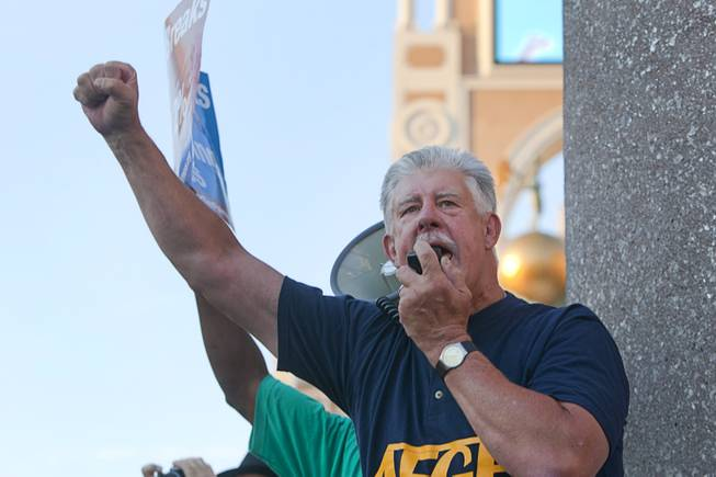 John Gage, national president for the American Federation of Government Employees (AFGE) union, rallies members as they picket against Republican vice presidential candidate Paul Ryan in front of the Venetian on the Las Vegas Strip Tuesday, Aug. 14, 2012. Ryan was reportedly meeting privately with a small group of supporters at the casino owned by Sheldon Adelson, a billionaire and major donor to Republican campaigns.