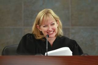 Judge Linda Bell smiles during a status check as she presides over specialty court Tuesday, August 14, 2012.