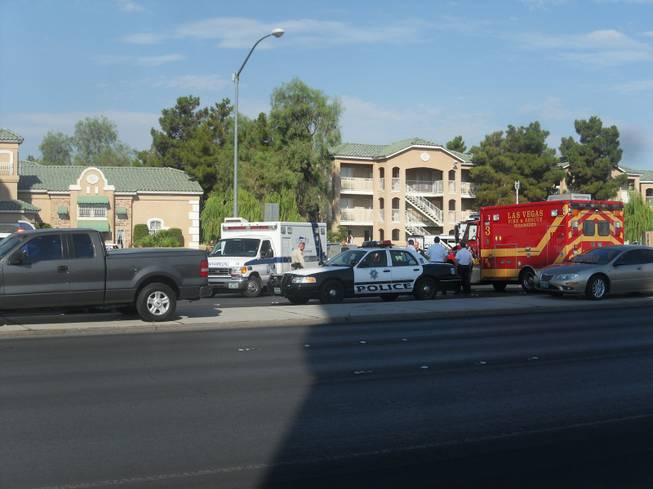A woman is in custody after holding a child hostage at the Budget Suites at 2219 N. Rancho Drive on Saturday, July 14, 2012.