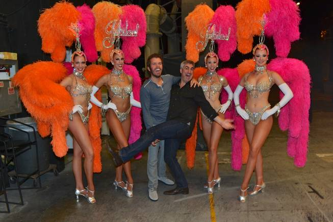 "Perez Hilton and Taylor Hicks are flanked by ""Jubilee!"" showgirls at Bally's."