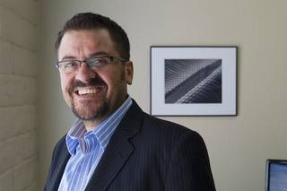 Anticoco Carrillo, executive director for Aid for AIDS of Nevada (AFAN), poses in his office Thursday, Aug. 16, 2012. AFAN will host their 26th Annual Black & White Party at the Hard Rock on Saturday, Aug. 25. AFAN provides support and advocacy for adults and children living with and affected by HIV/AIDS in southern Nevada.