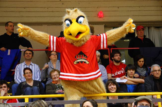 Victor, the mascot for the Rouge et Or of Laval University in Quebec City, Quebec, performs during a basketball game Feb. 17, 2012.