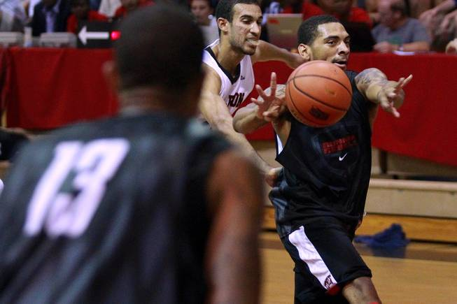 In his new role as point guard, UNLV's Anthony Marshall dishes off a pass to Bryce Dejean-Jones during their game against Carleton University in Ottawa, Ontario, Saturday, Aug. 18, 2012. The Rebels won the game 74-70, the first in a four-game exhibition tour in Canada.
