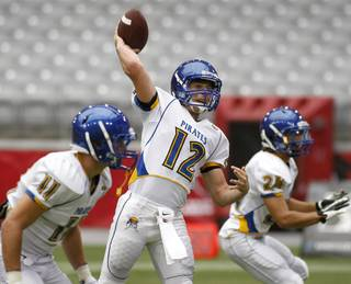 Moapa Valley quarterback Jake Repp throws a pass during pre-game warm-ups before the start of the 2012 AIA Sollenberger Classic football game against Blue Ridge on Saturday, Aug. 18, 2012 at University of Phoenix Stadium in Glendale, Ariz. (Ralph Freso for the Las Vegas Sun)