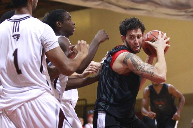 UNLV forward Carlos Lopez prepares to drive to the basket against the defense of the University of Ottawa during their game at Montpetit Hall in Ottawa, Ontario Sunday, August 19, 2012. UNLV won the game 89-76. The Runnin' Rebels are in the midst of a four-game exhibition tour in Canada.