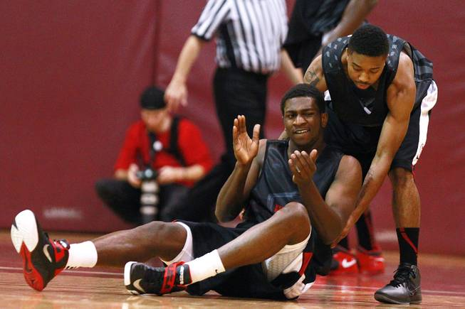 UNLV's Daquan Cook helps up teammate Savon Goodman during their game against the University of Ottawa at Montpetit Hall in Ottawa, Ontario Sunday, August 19, 2012. UNLV won the game 89-76. The Runnin' Rebels are in the midst of a four-game exhibition tour in Canada.