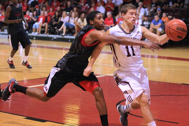 UNLV guard Justin Hawkins defends University of Ottawa guard Mike L'Africain during their game at Montpetit Hall in Ottawa, Ontario Sunday, August 19, 2012. UNLV won the game 89-76. The Runnin' Rebels are in the midst of a four-game exhibition tour in Canada.