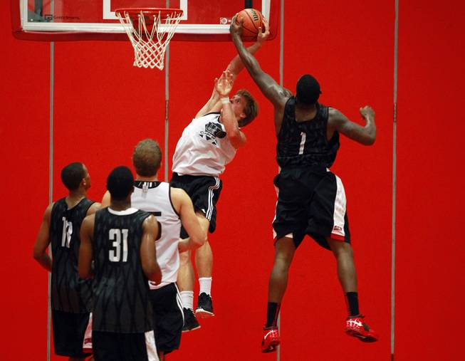 UNLV forward Quintrell Thomas blocks a dunk attempt by University of Laval forward Thibaud Dezutter during their game August 20, 2012 at McGill University in Montreal. The Runnin' Rebels dispatched the Rouge et Or 97-62.