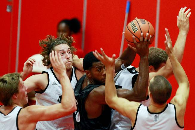 UNLV forward Mike Moser pulls a rebound down while surrounded by players from the University of Laval August 20, 2012 at McGill University in Montreal. The Runnin' Rebels dispatched the Rouge et Or 97-62.