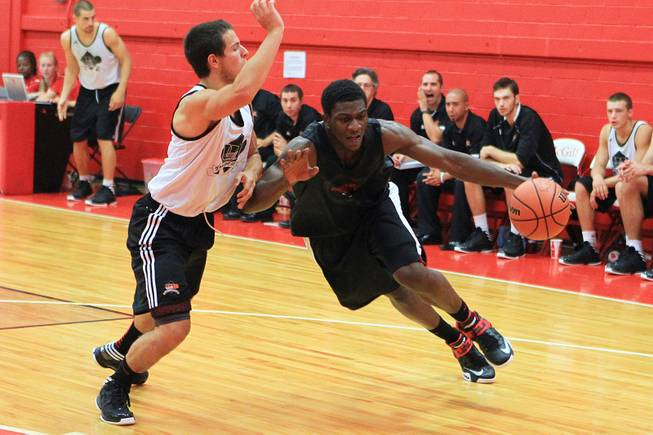 UNLV forward Savon Goodman drives against University of Laval guard Karl Demers-Belanger during their game August 20, 2012 at McGill University in Montreal. The Runnin' Rebels dispatched the Rouge et Or 97-62.