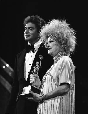 In this file photo provided by the Las Vegas News Bureau, comedian Phyllis Diller is on stage with singer Engelbert Humperdinck during the American Guild of Variety Artists (AGVA) at Caesars Palace in Las Vegas. 1-8-78.  She died on Monday, Aug. 20, 2012 at age 95.