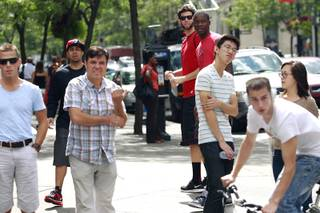 UNLV student manager Vic Armendariz, in cap, and players Carlos Lopez and Demetris Morant wait for teammates to catch up to them on rue Sainte-Catherine in Montreal while taking in the sights before their game against McGill University Tuesday, August 21, 2012.