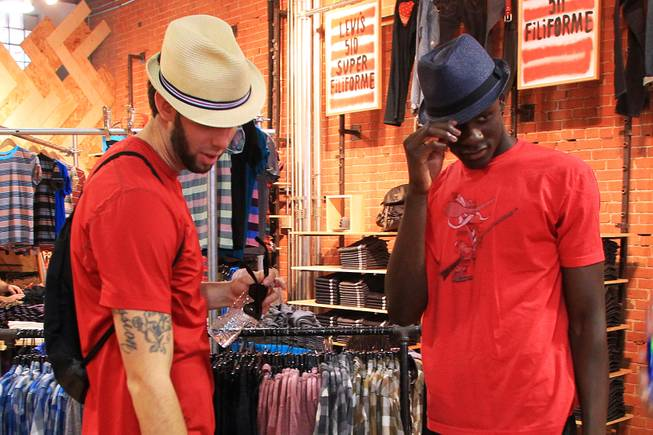 UNLV's Carlos Lopez and Demetris Morant check out some hats while shopping in Montreal as the do some sightseeing before their game against McGill University Tuesday, August 21, 2012.