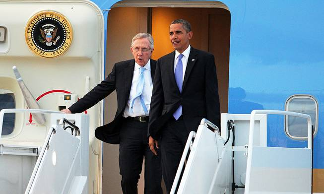 President Barack Obama and Senate Majority Leader Harry Reid arrive at Nellis Air Force Base on Tuesday, Aug. 21, 2012.