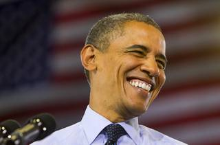 President Barack Obama smiles as he prepares to speak at a rally at Canyon Springs High School in North Las Vegas Wednesday, Aug. 22, 2012.