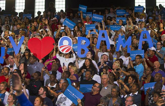 Supporters cheer as President Barack Obama as he is introduced at a rally at Canyon Springs High School in North Las Vegas Wednesday, Aug. 22, 2012.