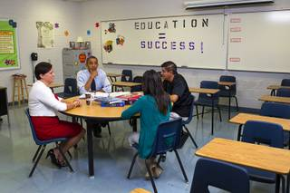 President Barack Obama holds a roundtable to discuss K-12 education with Clark County teachers Lori Elizabeth Henrickson, left, Isaac Barron and Claritssa Sanchez at Canyon Springs High School in North Las Vegas Wednesday, Aug. 22, 2012.